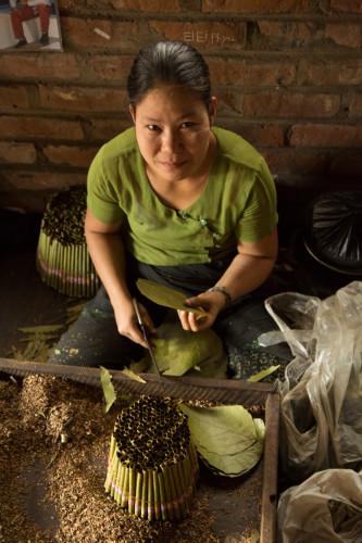 A lady rolls cheroots, Lower Burma