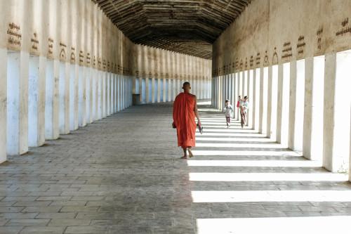 Monk in pagoda corridor